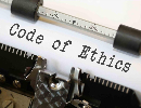 typerwriter typing code of ethics on white paper