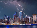 lightning in sky over buildings